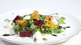 Cucumber salad with grilled tuna. Arugula and beet salad with goat cheese and candied nuts. Salad of lettuce, beetroot. And salmon fillets with a delicate cream stock video footage