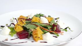 Cucumber salad with grilled tuna. Arugula and Beet Salad with Goat Cheese and Candied Nuts. Salad of lettuce, beetroot. And salmon fillets with a delicate cream stock video