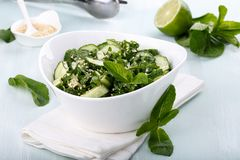 Cucumber salad with mint and sesame seeds royalty free stock image