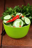 Cucumber salad with red chili pepper and cilantro Stock Photo