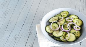 Cucumber salad with red onion Stock Photo