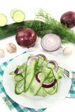 Cucumber salad with red onions Stock Photography