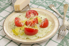 Cucumber salad with tomato on a plate Stock Photos