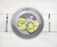 Cucumber sandwiches with knife and fork on white  table Stock Photography