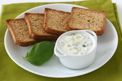 Cucumber sauce in a bowl. With toasts royalty free stock images