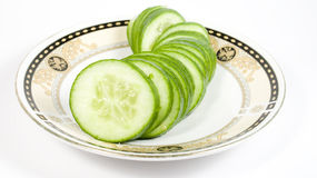 Cucumber on saucer. Slice's green cucumber on saucer on white Royalty Free Stock Photos
