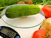 Cucumber on the scales Stock Photo