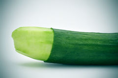 Cucumber with the skin of its tip removed Royalty Free Stock Photography