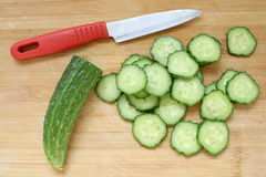 Cucumber slice. Cucumber and slices isolated over wood background Royalty Free Stock Photography