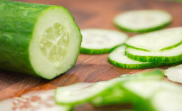 Cucumber. Sliced cucumber on cutting board close-up Royalty Free Stock Photo