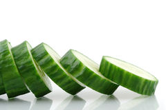 Cucumber Slices. Reflecting in a white background (shallow focus Royalty Free Stock Images