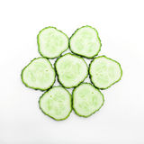 Cucumber slices. A close up view of a round display of thin cucumber slices on a white background Stock Photo