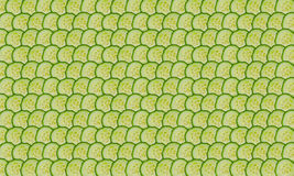 Cucumber slices. Thin cucumbers slices folded into rows as background Royalty Free Stock Photo