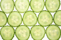 Cucumber slices. Slices of fresh cucumber isolated on backlit white background Stock Image