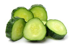 Cucumber and slices. Cucumber and slices on White Background Stock Photo