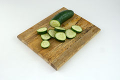 Cucumber slices on cutting board Royalty Free Stock Photo