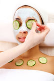 Cucumber slices on eyes Royalty Free Stock Photos