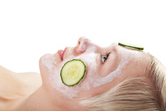 Cucumber slices on face masque Stock Photo