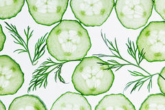 Cucumber slices. Green dill. Pattern. Food background. Royalty Free Stock Photos
