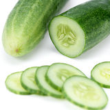Cucumber and slices isolated. Over white background Royalty Free Stock Photography