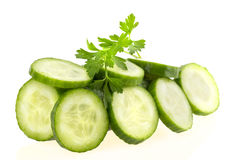 Cucumber and slices isolated over white background Stock Photography