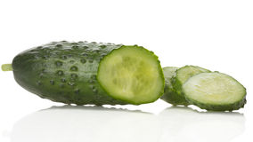 Cucumber and slices isolated over white background Stock Images