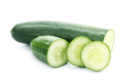 Cucumber and slices isolated over white background Stock Photos