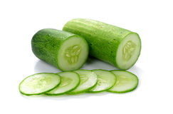 Cucumber and slices isolated over white background Royalty Free Stock Photos