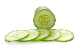 Cucumber and slices isolated over white background. Royalty Free Stock Images