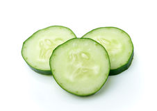 Cucumber and slices. Over white background Stock Image