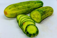 Cucumber and slices over white background. stock images