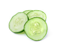 Cucumber and slices on over white background. Cucumber and slices isolated over white background Royalty Free Stock Images