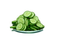 Cucumber slices on plate. On white background Stock Photo