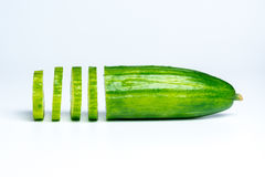 Cucumber slices from the side on white background Royalty Free Stock Photography