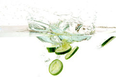 Cucumber slices in water. Fresh cucumber slices in cold water (splash Royalty Free Stock Photos