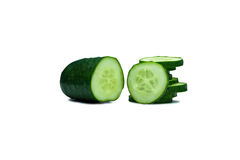 Cucumber with slices on white background. A piece of cucumber with slices on white background, side view Stock Photography