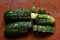 Cucumber slices. On a wooden board Stock Photo