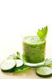 Cucumber smoothie. Glass of healthy green cucumber smoothie decorated with celery leaves Stock Image