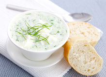 Cucumber soup with dill. And baguette bread Stock Photos