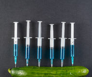 Cucumber and syringe Stock Images