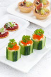 Cucumber tartlets with cream cheese and red caviar for holiday Stock Image