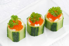 Cucumber tartlets with cream cheese and red caviar, top view Royalty Free Stock Image