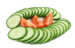 Cucumber and tomato. Isolated Slices of Tomato and Cucumber  on a white background Stock Images