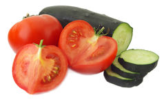 Cucumber and Tomato. Isolated on white background Stock Photos