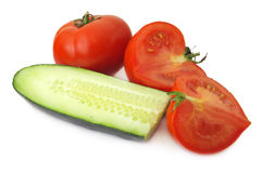 Cucumber and Tomato. Over white background Stock Images