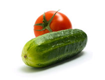 Cucumber and tomato Stock Images