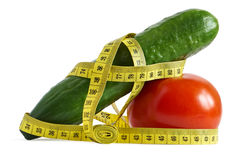 Cucumber and tomato with measuring tape Stock Photography