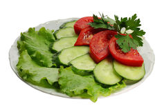 Cucumber and tomato segments Royalty Free Stock Images
