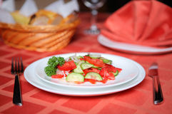 Cucumber tomatoe appetizing vegetable salad. Served on a table in restaurant Stock Photography