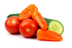 Cucumber tomatoes and peppers on a white background Stock Photos
